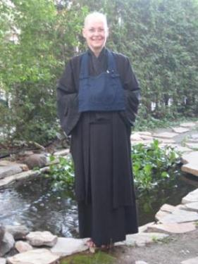 Picture of Ven. Jinmyo Renge osho standing in the garden at Dainen-ji