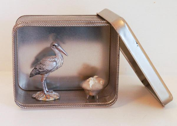 Silver heron and bowl in a perforated metal box